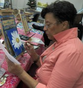 Jean puts finishing touches on her daisy