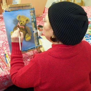 Kathy developing the bow on her Teddy bear painting