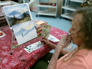Miss Charlotte painting a landscape