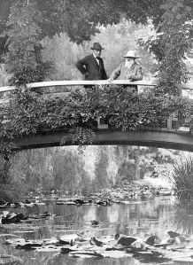 Monet (right) in his garden