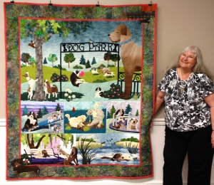 "Jackie Bourque with ""The Dog Park"" quilt"
