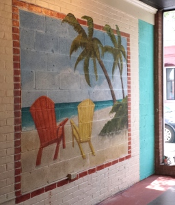 Finished mural with brick window detail.