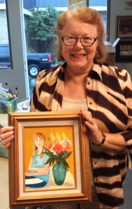 Kay with painting of Granddaughter