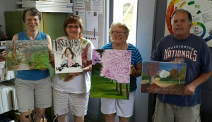 Gretchen, Janice, Kay and Mike with their paintings