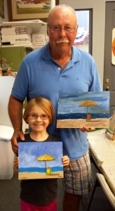 Maddie and Granddaddy (Jim) with their finished paintings