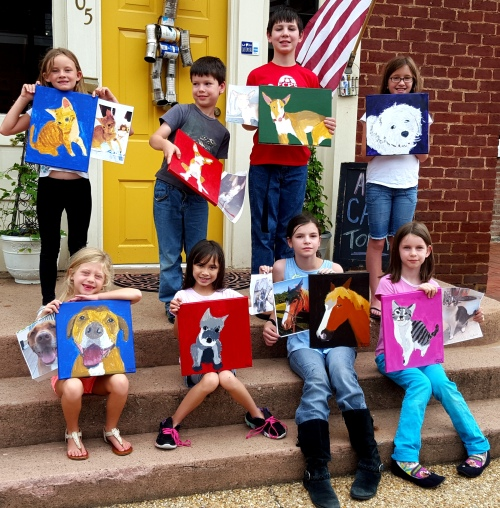 Kids with their pet paintings and reference photos