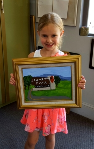 Daisy with her framed painting.