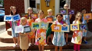 Young artists with their matted Gelli Prints