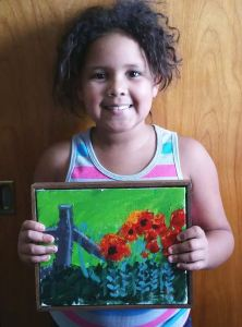 Hannah with framed poppy painting