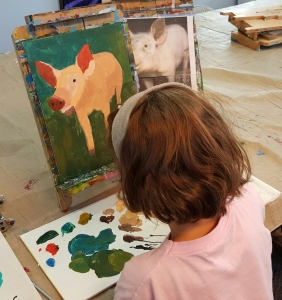 Sophia working on Pig painting